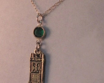 Necklace with 19th century standing book press & glass drop