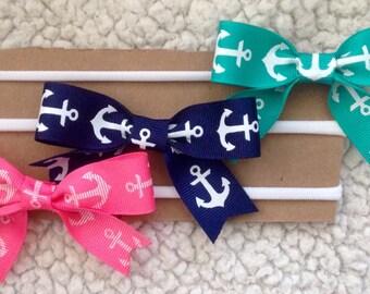 Dainty anchor bows on a white nylon headband! 3 colors avaliable