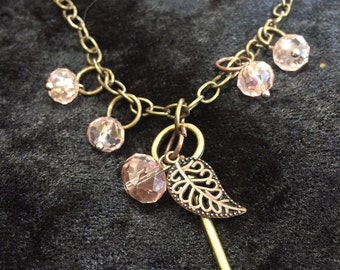 Key and pink crystal charm necklace with adjustable chain