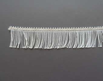 Vintage fringe trims, tassels in white with a small decorative top, timeless