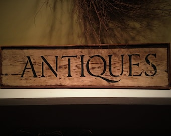 ANTIQUES sign.  100 year old wood part