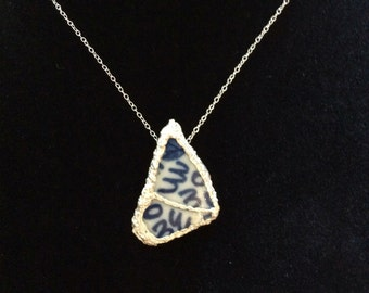 Porcelain and silver pendant