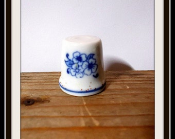 Vintage thimble of white ceramic.