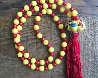 Yellow and Red Beaded Necklace with Red Tassel