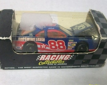 1996  Dale Jarrett Quality Care Red Carpet Lease RCCA #88  Hood Open 1 of 10,000 1/64 Scale NASCAR Diecast Car New In Damaged Package