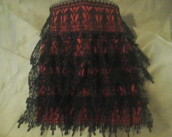red jabot with black lace
