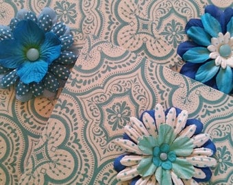 Blue and turquoise flower cards on patterned and textured background.