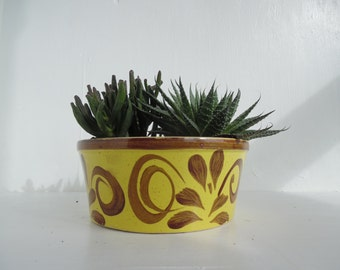 Mid century ceramic planter / plant bowl / plant pot, in yellow, with a hand painted swirl design