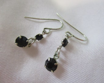 Silver Toned Earrings With Black Rhinestones