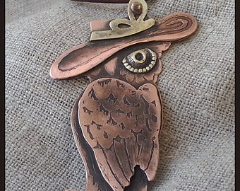 Women pendant-owl on the leather cord.