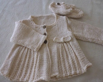Hand knitted Traditional style baby coat and shoes in 100 0/0 bamboo wool. 0-6 months