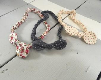 Thin knotted bow headband