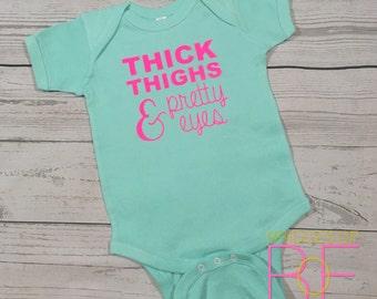 Thick Thighs & Pretty Eyes Short Sleeve Infant Baby Bodysuit