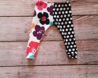 Baby/toddler leggings. Made from soft, stretchy, knit fabric. Vibrant floral print paired with polka dots!