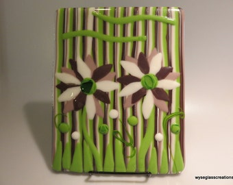 Fused glass art with purple and white flowers