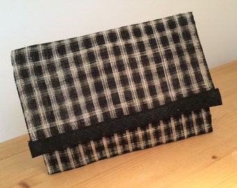 Black and cream checked clutch bag