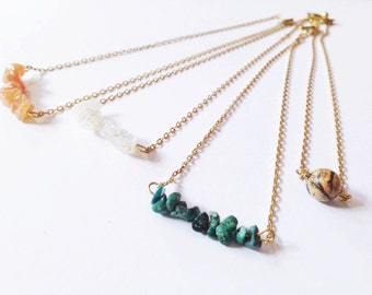 Cute little necklaces with crystals in different colors, close to the neck, choker