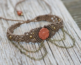 Pretty macramee upper arm jewelry with flowery gold flow in the middle  in brown decorated with chains, gipsystyle