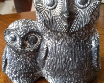 Mother owl with her owlet leaning in close, a charming and unusual sculpture from the NUVUK range of hand carved soapstone figures