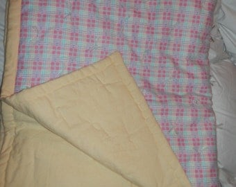 Pale yellow and pink checked baby blanket