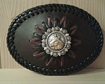 Oval buckle with leather