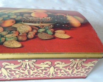 hinged tin box with silver plated wine coaster and fruit design.