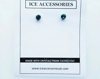 Solitaire studd earrings made with 6mm Blue Zircon Swarovski crystal. December Birthstone