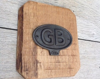 Cast iron GB plaque set on oak back