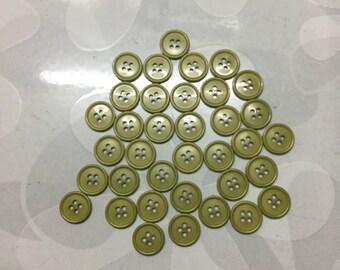 3 dozens of green buttons