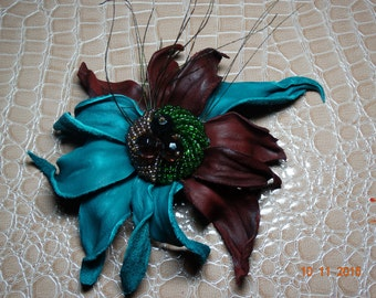 Leather brooch, flower with peacock feathers