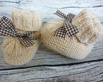 Knitted baby booties in natural colors with plaid ribbon.Knitted baby shoes. Newborn knitted baby booties.Ready to ship .