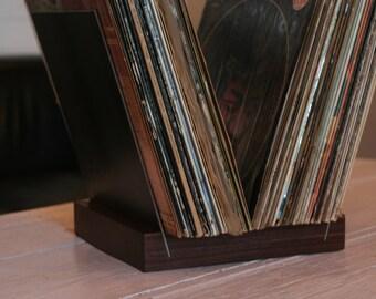 record storage  holds 50 twelve inch records walnut base