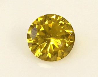Sapphire Gold Yellow. Corundum Swiss Lab created. Round 8 mm. 2 ct.