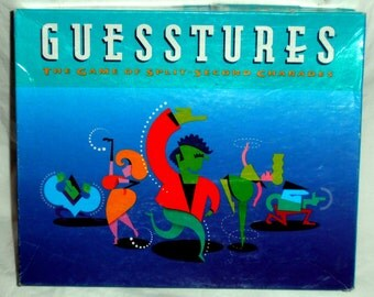 Guesstures The game of spilt second Charades by Milton Bradley 1990 Ages 12 and Up for 4 or more players/teams