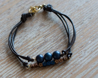 Handmade bracelet from brown leather and mineral stones