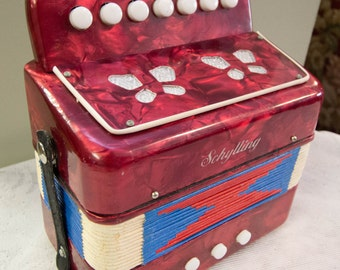 The Little Accordion With The Big Sound Child's musical toy from Schylling.