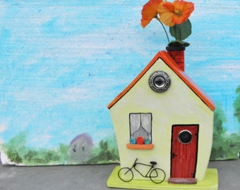 Decorative wooden house with flower vase