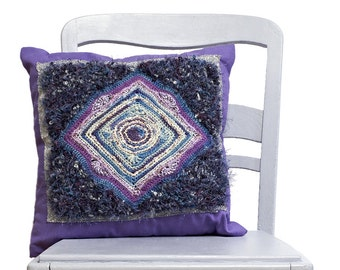 Purple knitted cushion