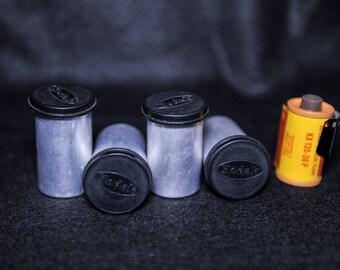 A set of four vintage empty metal & black plastic Kodak 35mm film canister's - 1970's