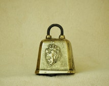 Vintage brass cowbell.