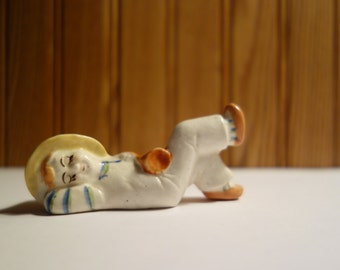 small resting figurine with hat made in occupied japan
