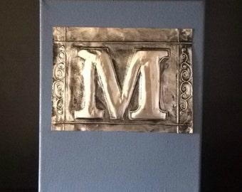 embossed metal letter