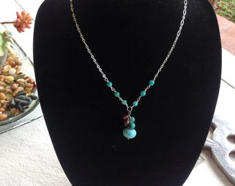 Teal colored stone and silver chain necklace