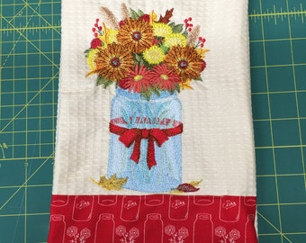 Embroidered kitchen towel with flower in a mason jar and accented material