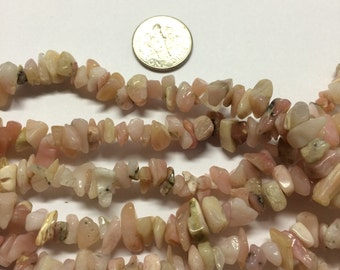 "5 strands Pink Opal chips. 36"" strands."