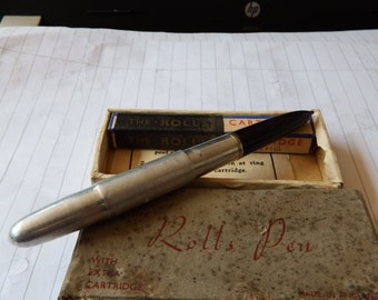 Vintage Pen. The Rolls Pen with extra ink cartridge. Made in England
