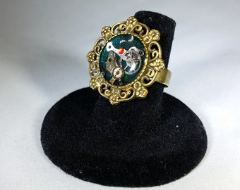 Steampunk Ring, watch gears & parts in resin on a emerald green background in an adjustable filigree setting SR15
