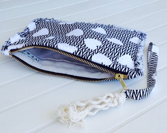 Bonnie fringed fabric zip pouch.