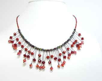 Red collar dark glass beads
