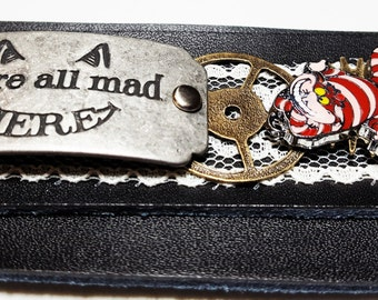Cheshire Cat Alice in Wonderland Leather and Lace Wrist Cuff - Steampunk Cheshire Cat Gift - We're All Mad Here -  Charm Bracelet Drink Me